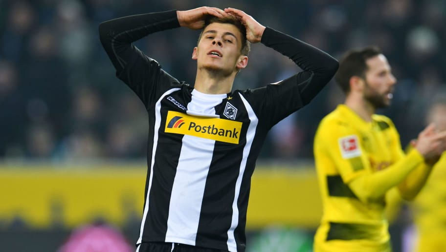 Moenchengladbach's Belgian forward Thorgan Hazard reacts during the German first division Bundesliga football match Borussia Moenchengladbach vs BVB Borussia Dortmund, in Moenchengladbach, western Germany, on February 18, 2018. / AFP PHOTO / Patrik STOLLARZ / RESTRICTIONS: DURING MATCH TIME: DFL RULES TO LIMIT THE ONLINE USAGE TO 15 PICTURES PER MATCH AND FORBID IMAGE SEQUENCES TO SIMULATE VIDEO. == RESTRICTED TO EDITORIAL USE == FOR FURTHER QUERIES PLEASE CONTACT DFL DIRECTLY AT + 49 69 650050         (Photo credit should read PATRIK STOLLARZ/AFP/Getty Images)