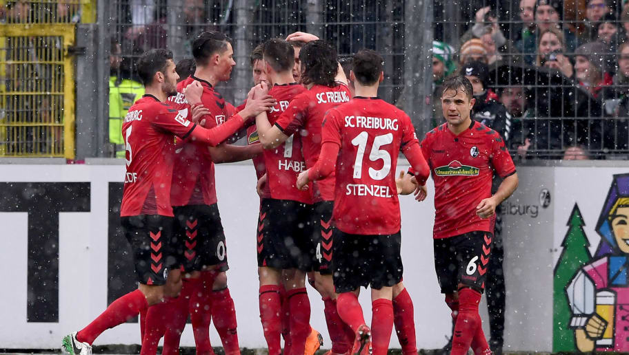 FREIBURG GERMANY - FEBRUARY 17: Players of SC Freiburg celebrate opening goal of Nils Petersen during the Bundesliga match between Sport-Club Freiburg and SV Werder Bremen at Schwarzwald-Stadion on February 17, 2018 in Freiburg, Germany.  (Photo by Michael Kienzler/Bongarts/Getty Images)