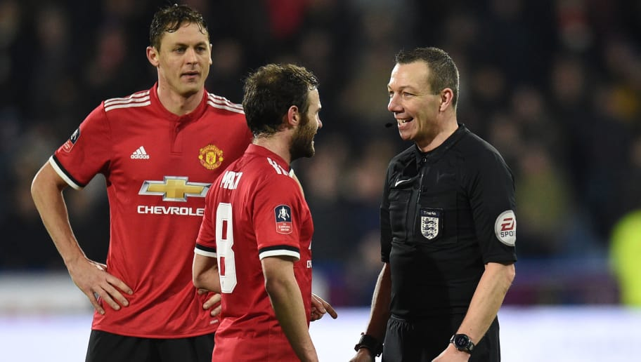 English referee Kevin Friend (R) chats with Manchester United's Spanish midfielder Juan Mata during the English FA Cup fifth round football match between Huddersfield Town and Manchester United at the John Smith's stadium in Huddersfield, northern England on February 17, 2018. / AFP PHOTO / Oli SCARFF / RESTRICTED TO EDITORIAL USE. No use with unauthorized audio, video, data, fixture lists, club/league logos or 'live' services. Online in-match use limited to 75 images, no video emulation. No use in betting, games or single club/league/player publications.  /         (Photo credit should read OLI SCARFF/AFP/Getty Images)
