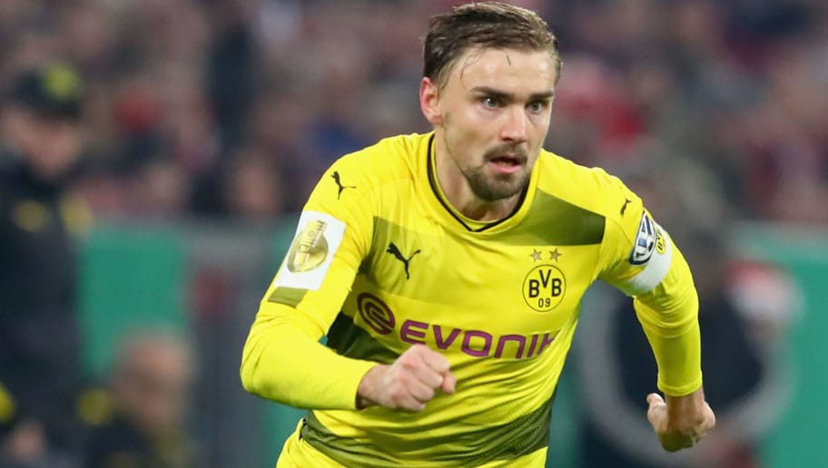 MUNICH, GERMANY - DECEMBER 20:  Marcel Schmelzer  of Dortmund runs with the ball during the DFB Cup match between Bayern Muenchen and Borussia Dortmund at Allianz Arena on December 20, 2017 in Munich, Germany.  (Photo by Alexander Hassenstein/Bongarts/Getty Images)