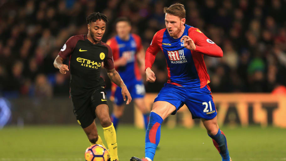 LONDON, ENGLAND - NOVEMBER 19: Connor Wickham of Crystal Palace (R) is put under pressure from Raheem Sterling of Manchester City (L) during the Premier League match between Crystal Palace and Manchester City at Selhurst Park on November 19, 2016 in London, England.  (Photo by Stephen Pond/Getty Images)