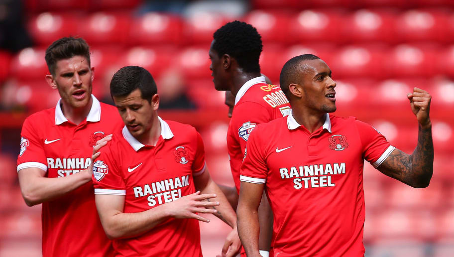 LONDON, ENGLAND - APRIL 16:  Jay Simpson of Leyton Orient celebrates with his team-mates after scoring his sides second goal during the Sky Bet League Two match between Leyton Orient and Dagenham & Redbridge at Brisbane Road on April 16, 2016 in London, England.  (Photo by Jordan Mansfield/Getty Images)