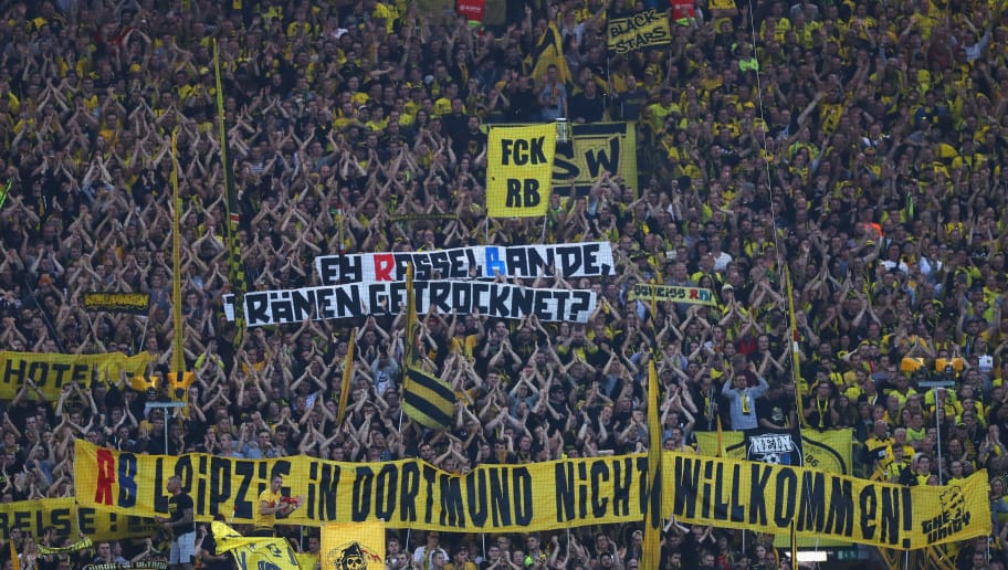 DORTMUND, GERMANY - OCTOBER 14:  Fans of Borussia Dortmund hold up signs and flags against the club of RB Leipzig during the Bundesliga match between Borussia Dortmund and RB Leipzig at Signal Iduna Park on October 14, 2017 in Dortmund, Germany.  (Photo by Dean Mouhtaropoulos/Bongarts/Getty Images)
