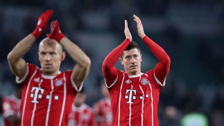 Bayern Munich's Polish forward Robert Lewandowski (R) and Dutch midfielder Arjen Robben (L) applaud the fans after the German first division Bundesliga football match VfL Wolfsburg vs FC Bayern Munich at Volkswagen Arena on February 17, 2018 in Wolfsburg, Germany. / AFP PHOTO / Ronny Hartmann / RESTRICTIONS: DURING MATCH TIME: DFL RULES TO LIMIT THE ONLINE USAGE TO 15 PICTURES PER MATCH AND FORBID IMAGE SEQUENCES TO SIMULATE VIDEO. == RESTRICTED TO EDITORIAL USE == FOR FURTHER QUERIES PLEASE CONTACT DFL DIRECTLY AT + 49 69 650050         (Photo credit should read RONNY HARTMANN/AFP/Getty Images)