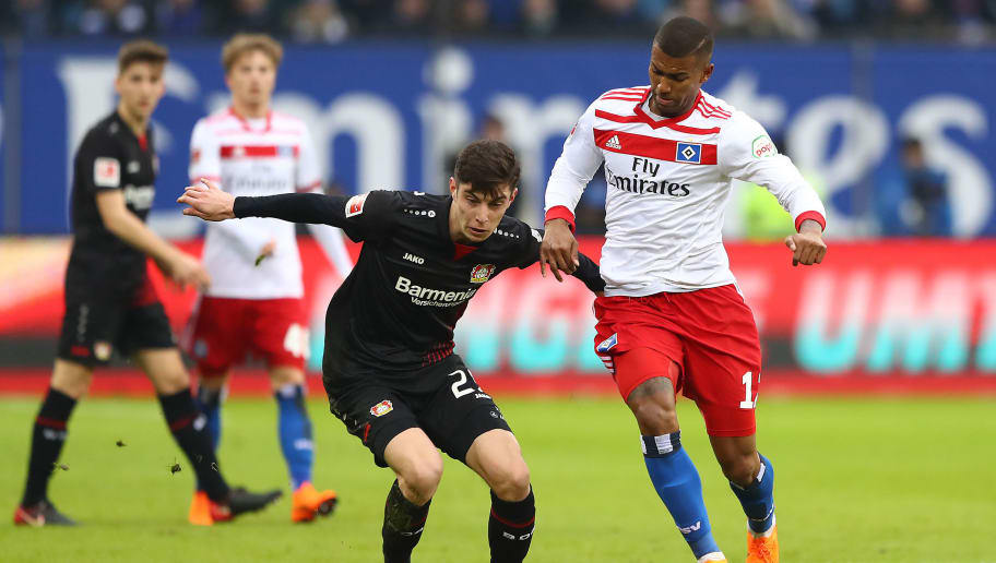 HAMBURG, GERMANY - FEBRUARY 17: Kai Havertz of Bayer Leverkusen (l) fights for the ball with Walace of Hamburg during the Bundesliga match between Hamburger SV and Bayer 04 Leverkusen at Volksparkstadion on February 17, 2018 in Hamburg, Germany. (Photo by Martin Rose/Bongarts/Getty Images)
