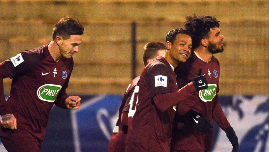 FC Metz's Emmanuel Jose Riviere (R) is congratulated by teammates after scoring during the French Cup round of 32 football match between Dunkerque and Metz at The Marcel-Tribut Stadium in Dunkirk on January 7, 2018.  / AFP PHOTO / FRANCOIS LO PRESTI        (Photo credit should read FRANCOIS LO PRESTI/AFP/Getty Images)