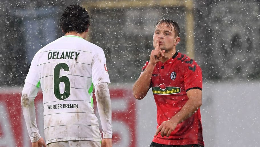 FREIBURG GERMANY - FEBRUARY 17: Amir Abrashi (R) of SC Freiburg gestures to Thomas Delaney (L) of SV Werder Bremen during the Bundesliga match between Sport-Club Freiburg and SV Werder Bremen at Schwarzwald-Stadion on February 17, 2018 in Freiburg, Germany.  (Photo by Michael Kienzler/Bongarts/Getty Images)