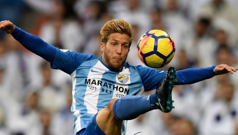 Malaga's Spanish midfielder Keko Gontan controls the ball during the Spanish league football match Real Madrid CF against Malaga CF on 25, November 2017 at the Santiago Bernabeu stadium in Madrid. / AFP PHOTO / GABRIEL BOUYS        (Photo credit should read GABRIEL BOUYS/AFP/Getty Images)