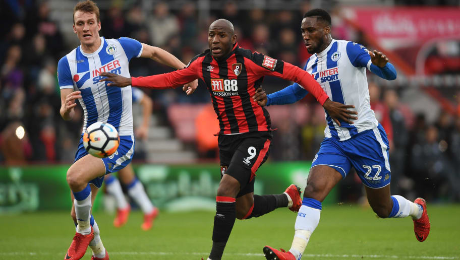 BOURNEMOUTH, ENGLAND - JANUARY 06:  Dan Burn (L) and Cheyenne Dunkley of Wigan Athletic challenge Benik Afobe of AFC Bournemouth during the The Emirates FA Cup Third Round match between AFC Bournemouth and Wigan Athletic at Vitality Stadium on January 6, 2018 in Bournemouth, England.  (Photo by Mike Hewitt/Getty Images)