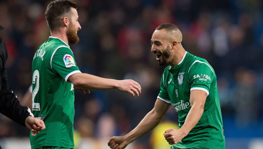 MADRID, SPAIN - JANUARY 24:  Nabil El Zhar (right) of CD Leganes celebrates with Roberto Triguero ÔÕTitoÕÕ of after they beat Real Madrid 2-1 (0-1) on aggregate in the Copa del Rey, Quarter Final, Second Leg match between Real Madrid and Leganes at the Santiago Bernabeu stadium on January 24, 2018 in Madrid, Spain. (Photo by Denis Doyle/Getty Images)
