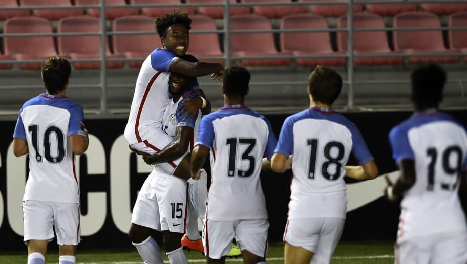 US footballer Zyen Jones (15) celebrates with teammates after scoring against Cuba during an Under-17 Concacaf qualifying football match at the Maracana stadium on May 5, 2017 in Panama City. / AFP PHOTO / RODRIGO ARANGUA        (Photo credit should read RODRIGO ARANGUA/AFP/Getty Images)