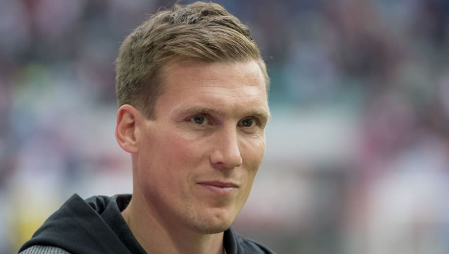 Stuttgart's head coach Hannes Wolf looks on prior to the German first division Bundesliga football match between RB Leipzig and VfB Stuttgart in Leipzig, eastern Germany, on October 21, 2017.  / AFP PHOTO / ROBERT MICHAEL / RESTRICTIONS: DURING MATCH TIME: DFL RULES TO LIMIT THE ONLINE USAGE TO 15 PICTURES PER MATCH AND FORBID IMAGE SEQUENCES TO SIMULATE VIDEO. == RESTRICTED TO EDITORIAL USE == FOR FURTHER QUERIES PLEASE CONTACT DFL DIRECTLY AT + 49 69 650050         (Photo credit should read ROBERT MICHAEL/AFP/Getty Images)