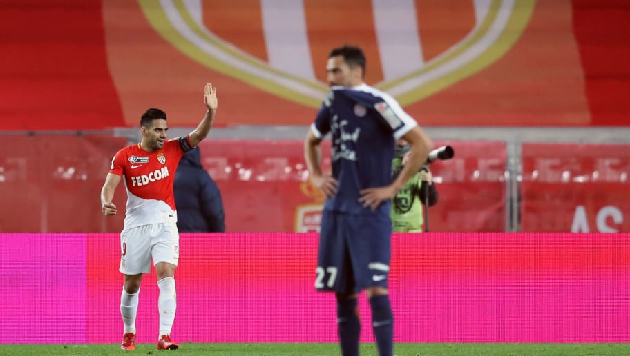 Monaco's Colombian forward Radamel Falcao celebrates after scoring goal during the French League Cup semi-final football match between Monaco and Montpellier at the Louis II stadium in Monaco on January 31, 2018. / AFP PHOTO / VALERY HACHE        (Photo credit should read VALERY HACHE/AFP/Getty Images)