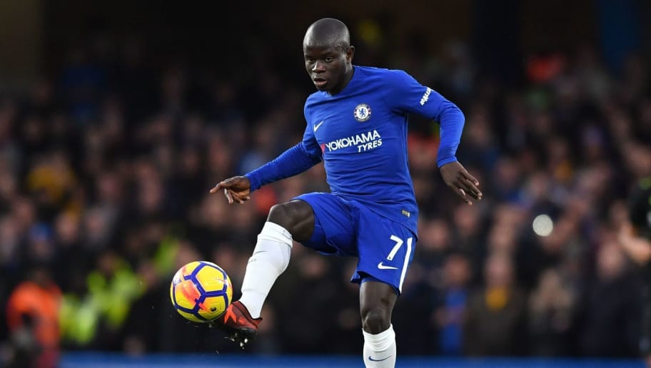 Chelsea's French midfielder N'Golo Kante passes the ball during the English Premier League football match between Chelsea and Brighton and Hove Albion at Stamford Bridge in London on December 26, 2017. / AFP PHOTO / Ben STANSALL / RESTRICTED TO EDITORIAL USE. No use with unauthorized audio, video, data, fixture lists, club/league logos or 'live' services. Online in-match use limited to 75 images, no video emulation. No use in betting, games or single club/league/player publications.  /         (Photo credit should read BEN STANSALL/AFP/Getty Images)
