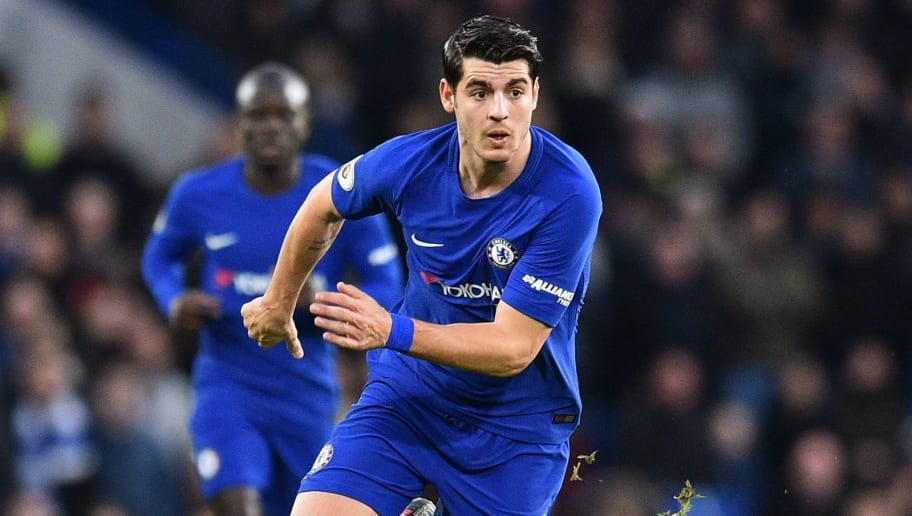 Chelsea's Spanish striker Alvaro Morata runs with the ball during the English Premier League football match between Chelsea and Brighton and Hove Albion at Stamford Bridge in London on December 26, 2017. / AFP PHOTO / Glyn KIRK / RESTRICTED TO EDITORIAL USE. No use with unauthorized audio, video, data, fixture lists, club/league logos or 'live' services. Online in-match use limited to 75 images, no video emulation. No use in betting, games or single club/league/player publications.  /         (Photo credit should read GLYN KIRK/AFP/Getty Images)