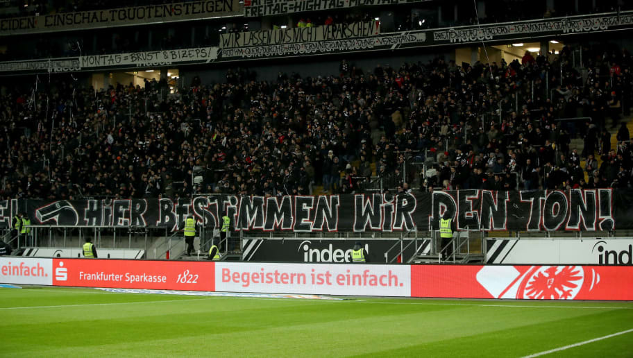 FRANKFURT AM MAIN, GERMANY - FEBRUARY 19:  Fans of Eintracht Frankfurt protest against the ongoing changes to kick off times ahead the Bundesliga match between between Eintracht Frankfurt and RB Leipzig at Commerzbank-Arena on February 19, 2018 in Frankfurt am Main, Germany. Fans are calling for a return to the standard kick off time of 15:30 on Saturday. All changes made by the League council were accompanied by large but non-violent protests.  (Photo by Alex Grimm/Bongarts/Getty Images)