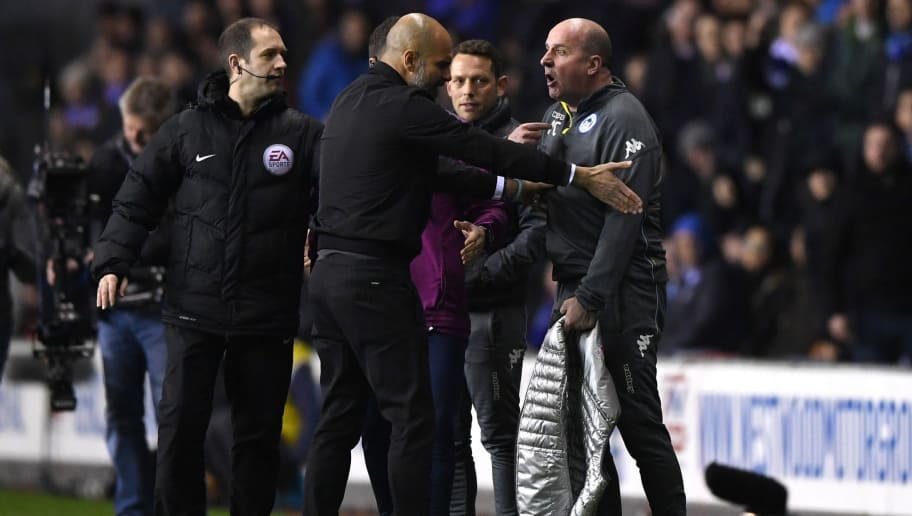 WIGAN, ENGLAND - FEBRUARY 19:  Josep Guardiola, Manager of Manchester City argues with Paul Cook, Manager of Wigan Athletic during the Emirates FA Cup Fifth Round match between Wigan Athletic and Manchester City at DW Stadium on February 19, 2018 in Wigan, England.  (Photo by Gareth Copley/Getty Images)