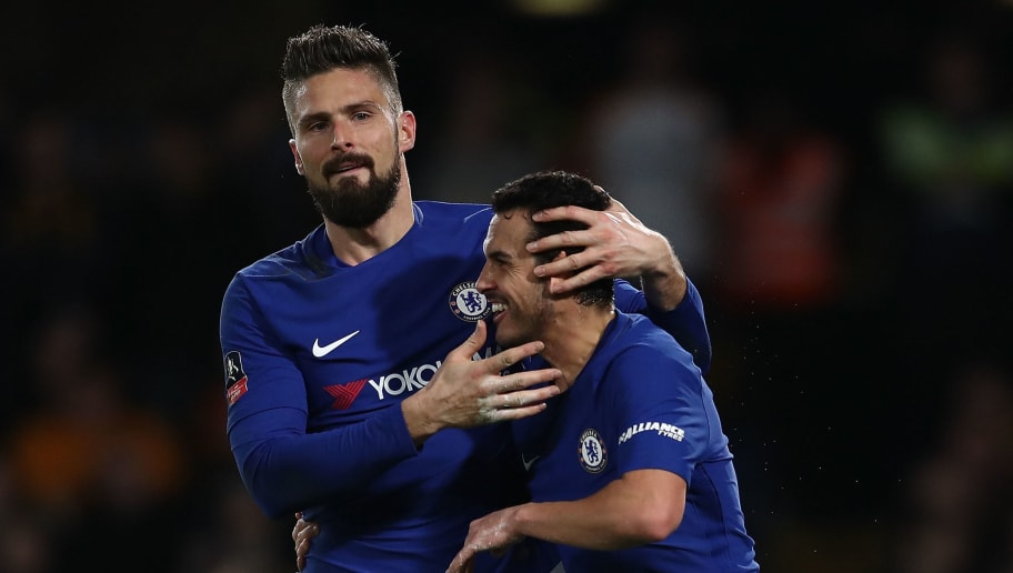 LONDON, ENGLAND - FEBRUARY 16:  Pedro of Chelsea celebrates with team mate Olivier Giroud after scoring his team's second goal of the game during The Emirates FA Cup Fifth Round match between Chelsea and Hull City at Stamford Bridge on February 16, 2018 in London, England.  (Photo by Catherine Ivill/Getty Images)