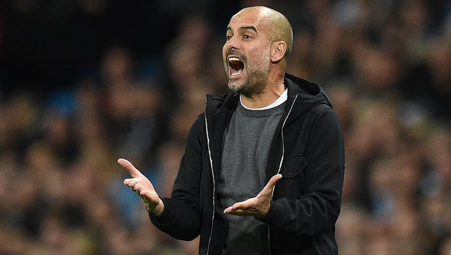 Manchester City's Spanish manager Pep Guardiola shouts instructions to his players from the touchline during the UEFA Champions League Group F football match between Manchester City and Napoli at the Etihad Stadium in Manchester, north west England, on October 17, 2017. / AFP PHOTO / Oli SCARFF        (Photo credit should read OLI SCARFF/AFP/Getty Images)