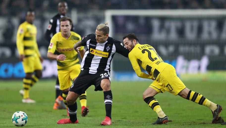 MOENCHENGLADBACH, GERMANY - FEBRUARY 18: Raul Bobadilla of Moenchengladbach is held by Gonzalo Castro of Dortmund during the Bundesliga match between Borussia Moenchengladbach and Borussia Dortmund at Borussia-Park on February 18, 2018 in Moenchengladbach, Germany.  (Photo by Alex Grimm/Bongarts/Getty Images)