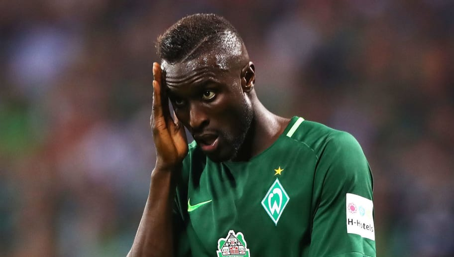 BREMEN, GERMANY - OCTOBER 15:  Lamine Sane of Werder Bremen is dejected during the Bundesliga match between SV Werder Bremen and Borussia Moenchengladbach at Weserstadion on October 15, 2017 in Bremen, Germany.  (Photo by Martin Rose/Bongarts/Getty Images)