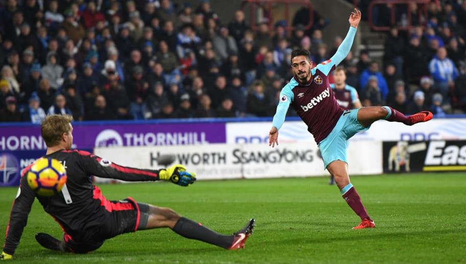 HUDDERSFIELD, ENGLAND - JANUARY 13: Manuel Lanzini of West Ham United scores his sides third goal during the Premier League match between Huddersfield Town and West Ham United at John Smith's Stadium on January 13, 2018 in Huddersfield, England.  (Photo by Gareth Copley/Getty Images)