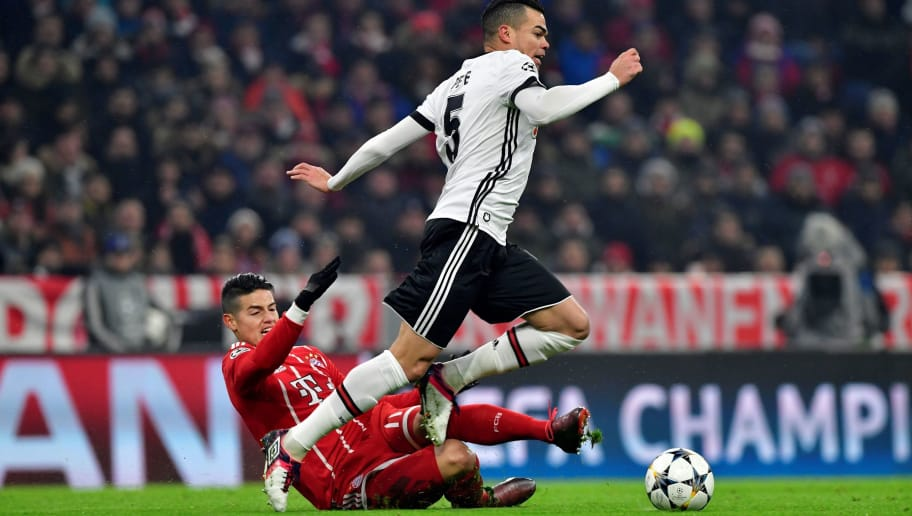 Bayern Munich's Colombian midfielder James Rodriguez (L) and Besiktas' Portuguese defender Pepe vie with the ball during the UEFA Champions League round of sixteen first leg football match Bayern Munich vs Besiktas Istanbul on February 20, 2018 in Munich, southern Germany. / AFP PHOTO / John MACDOUGALL        (Photo credit should read JOHN MACDOUGALL/AFP/Getty Images)