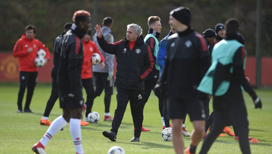 Manchester United's Portuguese manager Jose Mourinho (C) leads a team training session at the club's training complex near Carrington, west of Manchester in north west England on February 20, 2018, on the eve of their UEFA Champions League round of 16 football match against Sevilla. / AFP PHOTO / Oli SCARFF        (Photo credit should read OLI SCARFF/AFP/Getty Images)
