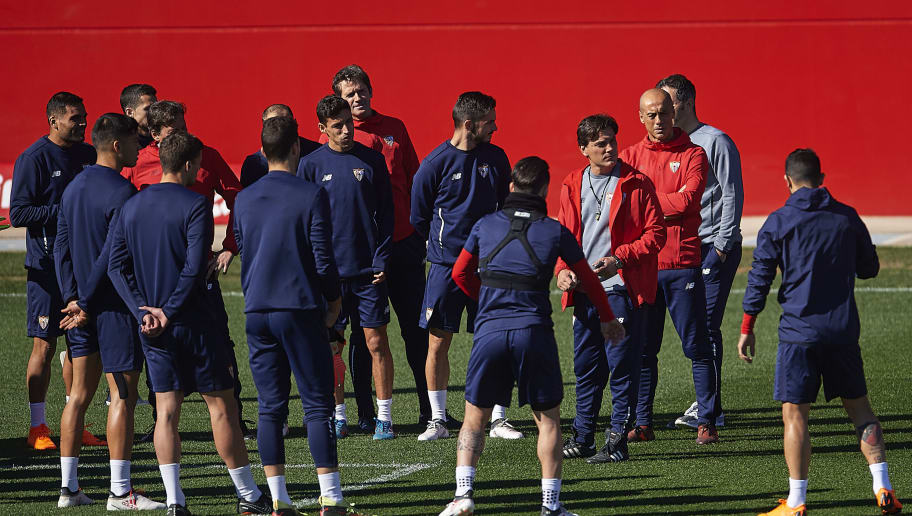 SEVILLE, SPAIN - FEBRUARY 20:  Head Coach of Sevilla FC Vincenzo Montella speaks with the players during a Sevilla FC training session prior to their UEFA Champions League match against Manchester United at Ramon Cisneros training ground on February 20, 2018 in Seville, Spain.  (Photo by Aitor Alcalde/Getty Images)