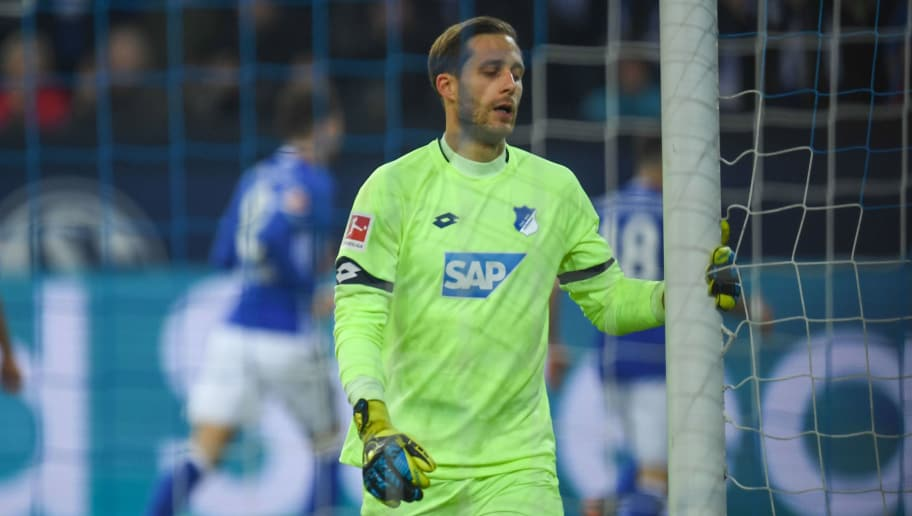 Hoffenheim's German goalkeeper Oliver Baumann reacts during the German first division Bundesliga football match FC Schalke 04 vs Hoffenheim, in Gelsenkirchen, western Germany, on February 17, 2018. / AFP PHOTO / Patrik STOLLARZ / RESTRICTIONS: DURING MATCH TIME: DFL RULES TO LIMIT THE ONLINE USAGE TO 15 PICTURES PER MATCH AND FORBID IMAGE SEQUENCES TO SIMULATE VIDEO. == RESTRICTED TO EDITORIAL USE == FOR FURTHER QUERIES PLEASE CONTACT DFL DIRECTLY AT + 49 69 650050 (Photo credit should read PATRIK STOLLARZ/AFP/Getty Images)
