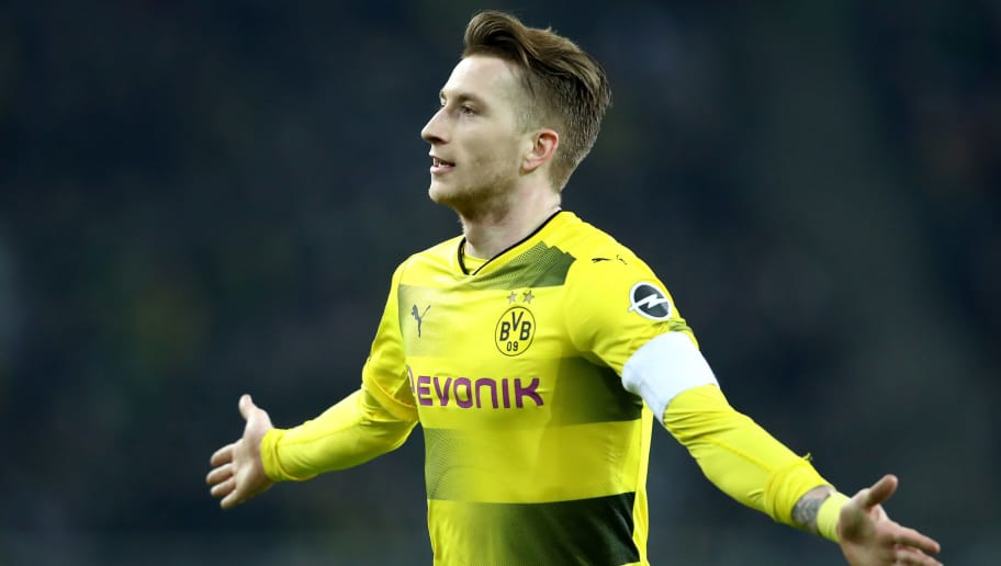 MOENCHENGLADBACH, GERMANY - FEBRUARY 18: Marco Reus of Dortmund celebrates the first goal during to the Bundesliga match between Borussia Moenchengladbach and Borussia Dortmund at Borussia-Park on February 18, 2018 in Moenchengladbach, Germany. (Photo by Christof Koepsel/Bongarts/Getty Images)