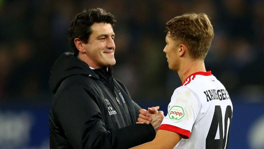 HAMBURG, GERMANY - NOVEMBER 04: Jens Todt (L), sport director of Hamburg celebrate with Fiete Arp after the Bundesliga match between Hamburger SV and VfB Stuttgart at Volksparkstadion on November 4, 2017 in Hamburg, Germany.  (Photo by Martin Rose/Bongarts/Getty Images)