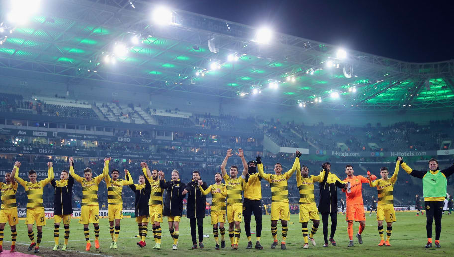 MOENCHENGLADBACH, GERMANY - FEBRUARY 18: Players of Dortmund celebrate with the fans after the Bundesliga match between Borussia Moenchengladbach and Borussia Dortmund at Borussia-Park on February 18, 2018 in Moenchengladbach, Germany.  (Photo by Alex Grimm/Bongarts/Getty Images)