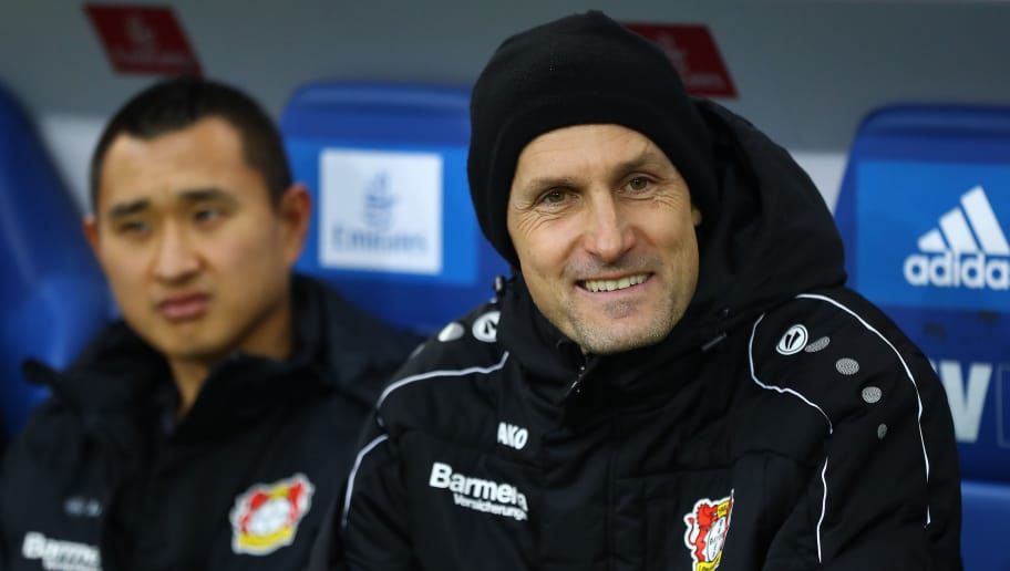 HAMBURG, GERMANY - FEBRUARY 17: Heiko Herrlich, coach of Bayer Leverkusen, smiles before the Bundesliga match between Hamburger SV and Bayer 04 Leverkusen at Volksparkstadion on February 17, 2018 in Hamburg, Germany. (Photo by Martin Rose/Bongarts/Getty Images)