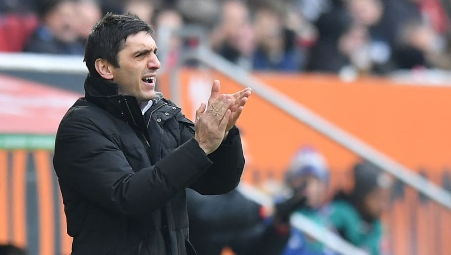 AUGSBURG, GERMANY - FEBRUARY 18: Head coach Tayfun Korkut of Stuttgart applauds his team during the Bundesliga match between FC Augsburg and VfB Stuttgart at WWK-Arena on February 18, 2018 in Augsburg, Germany. (Photo by Sebastian Widmann/Bongarts/Getty Images)