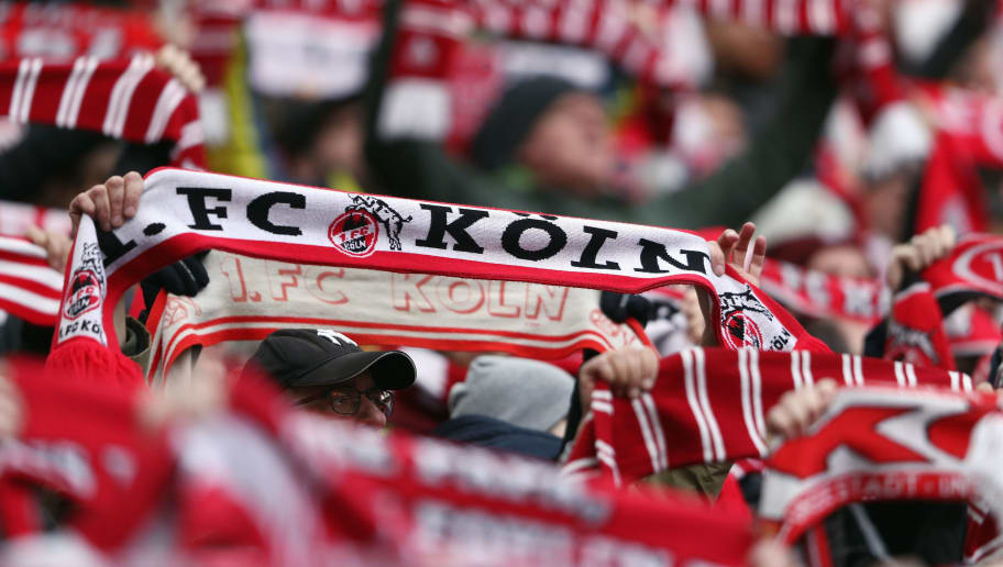 COLOGNE, GERMANY - FEBRUARY 17:  Fans of Koeln hold up their scarves during the Bundesliga match between 1. FC Koeln and Hannover 96 at RheinEnergieStadion on February 17, 2018 in Cologne, Germany.  (Photo by Alex Grimm/Bongarts/Getty Images)
