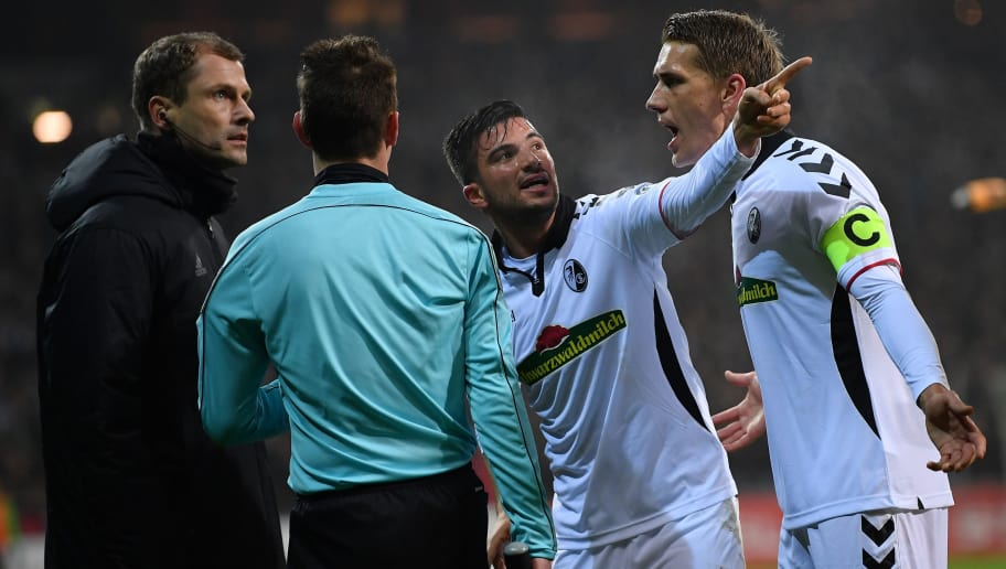 BREMEN, GERMANY - DECEMBER 20:  Marco Terrazzino  and Nils Petersen of Freiburg speaks with the linesman after the third Bremen goal during the DFB Cup match between Werder Bremen and SC Freiburg at Weserstadion on December 20, 2017 in Bremen, Germany.  (Photo by Stuart Franklin/Bongarts/Getty Images)