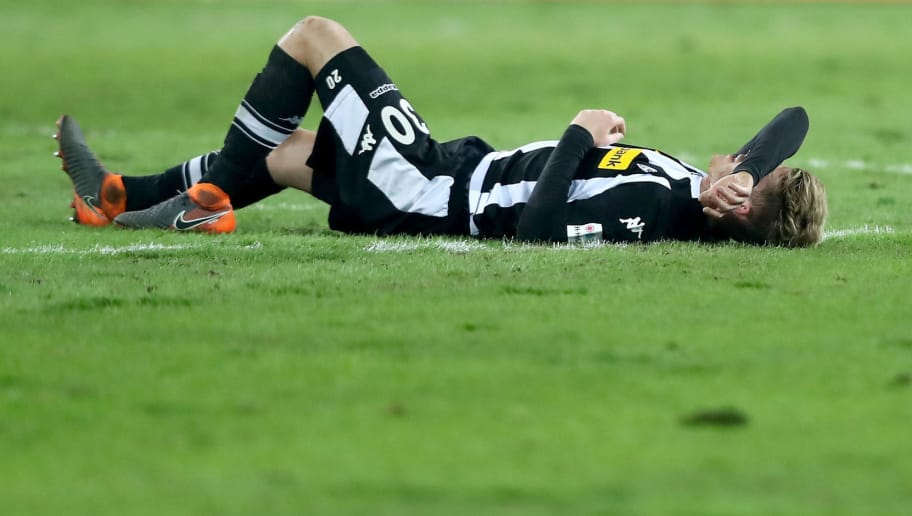 MOENCHENGLADBACH, GERMANY - FEBRUARY 18: Nico Elvedi of Moenchengladbach lies on the pitch after the Bundesliga match between Borussia Moenchengladbach and Borussia Dortmund at Borussia-Park on February 18, 2018 in Moenchengladbach, Germany. The match between Moenchengladbach and Dortmund ended 0-1. (Photo by Christof Koepsel/Bongarts/Getty Images)