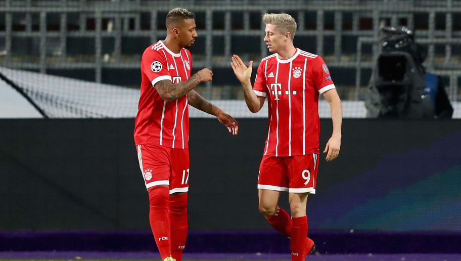 BRUSSELS, BELGIUM - NOVEMBER 22: Jerome Boateng (L) of Bayern Muenchen congratulates opening goalscorer Robert Lewandowski during the UEFA Champions League group B match between RSC Anderlecht and Bayern Muenchen at Constant Vanden Stock Stadium on November 22, 2017 in Brussels, Belgium.  (Photo by Dean Mouhtaropoulos/Getty Images)
