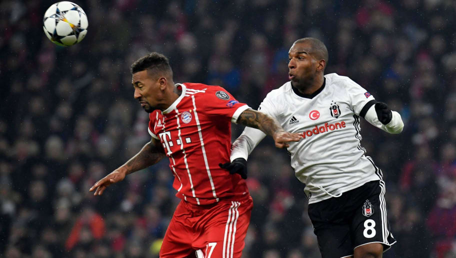 Bayern Munich's defender Jerome Boateng (L) and Besiktas' Dutch midfielder Ryan Babel vie for the ball  during the UEFA Champions League round of sixteen first leg football match Bayern Munich vs Besiktas Istanbul on February 20, 2018 in Munich, southern Germany. / AFP PHOTO / THOMAS KIENZLE        (Photo credit should read THOMAS KIENZLE/AFP/Getty Images)