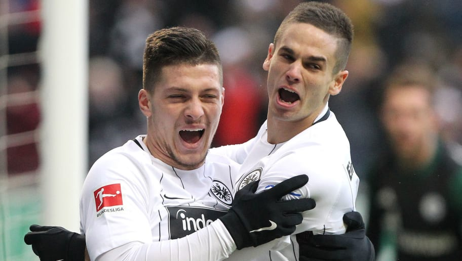 Frankfurt's Serbian forward Luka Jovic (L) celebrates with teammate midfielder Mijat Gacinovic after scoring the first goal during the German first division Bundesliga football match between FC Schalke 04 and Eintracht Frankfurt on December 16, 2017 in Frankfurt am Main, western Germany. / AFP PHOTO / Daniel ROLAND / RESTRICTIONS: DURING MATCH TIME: DFL RULES TO LIMIT THE ONLINE USAGE TO 15 PICTURES PER MATCH AND FORBID IMAGE SEQUENCES TO SIMULATE VIDEO. == RESTRICTED TO EDITORIAL USE == FOR FURTHER QUERIES PLEASE CONTACT DFL DIRECTLY AT + 49 69 650050         (Photo credit should read DANIEL ROLAND/AFP/Getty Images)