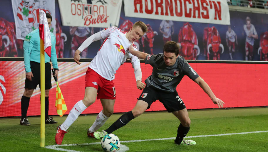LEIPZIG, GERMANY - FEBRUARY 09:  Lukas Klostermann of RB Leipzig is challenged by Raphael Framberger of FC Augsburg during the Bundesliga match between RB Leipzig and FC Augsburg at Red Bull Arena on February 9, 2018 in Leipzig, Germany.  (Photo by Boris Streubel/Bongarts/Getty Images)