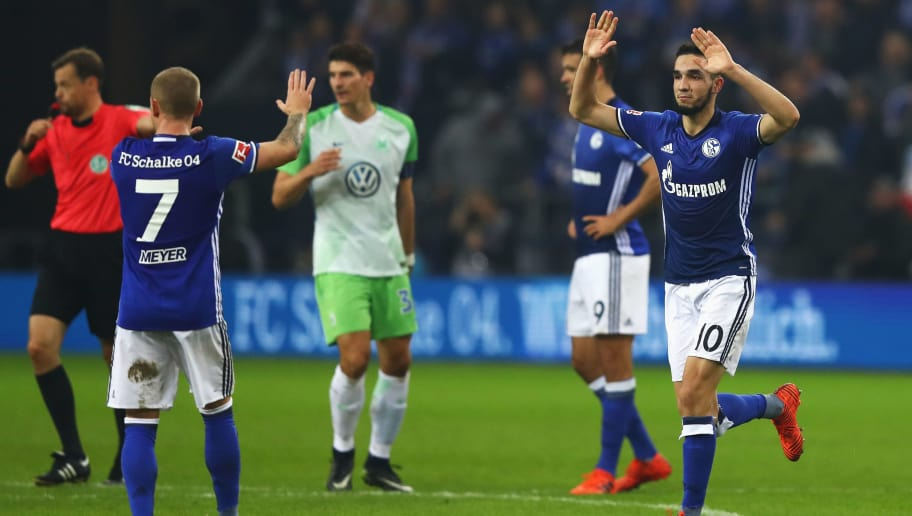 GELSENKIRCHEN, GERMANY - OCTOBER 28:  Nabil Bentaleb of Schalke 04 celebrates scoring his teams first goal of the game with team mate Max Meyer during the Bundesliga match between FC Schalke 04 and VfL Wolfsburg at Veltins-Arena on October 28, 2017 in Gelsenkirchen, Germany.  (Photo by Dean Mouhtaropoulos/Bongarts/Getty Images)