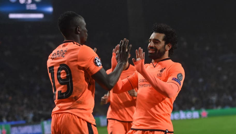 Liverpool's Senegalese midfielder Sadio Mane (L) celebrates with Liverpool's Egyptian midfielder Mohamed Salah after scoring their third goal during the UEFA Champions League round of sixteen first leg football match between FC Porto and Liverpool at the Dragao stadium in Porto, Portugal on February 14, 2018. Liverpool won the game 5-0. / AFP PHOTO / Francisco LEONG        (Photo credit should read FRANCISCO LEONG/AFP/Getty Images)