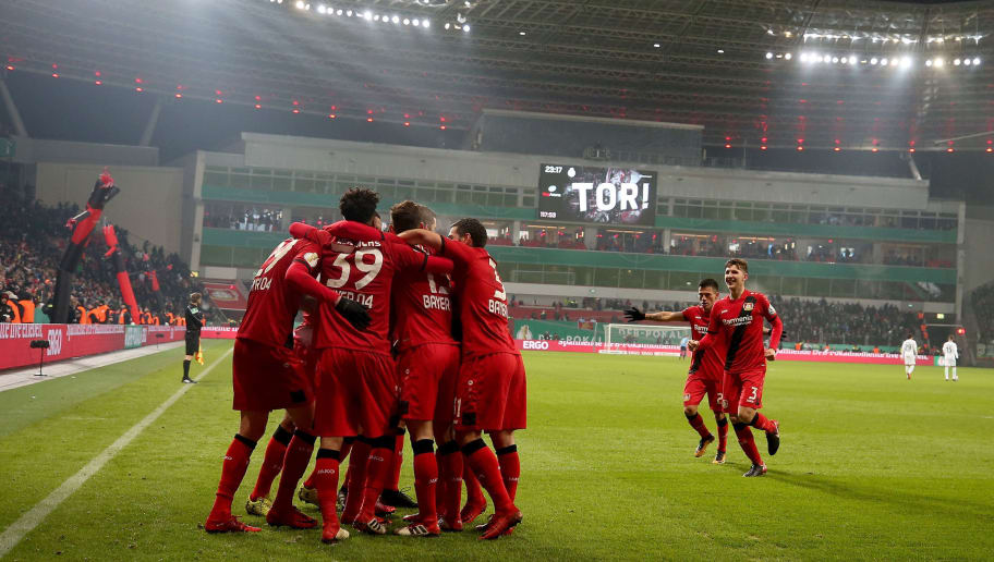 LEVERKUSEN, GERMANY - FEBRUARY 06:  Kai Havertz (obscure) of Leverkusen celebrates after he scores the 4th goal during extra time during the DFB Cup quarter final match between Bayer Leverkusen and Werder Bremen at BayArena on February 6, 2018 in Leverkusen, Germany.  (Photo by Alex Grimm/Bongarts/Getty Images)