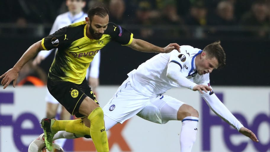 DORTMUND, GERMANY - FEBRUARY 15:  Omer Toprak of Borussia Dortmund and Hans Hateboer of Atalanta during UEFA Europa League Round of 32 match between Borussia Dortmund and Atalanta Bergamo at the Signal Iduna Park on February 15, 2018 in Dortmund, Germany.  (Photo by Alex Grimm/Bongarts/Getty Images)
