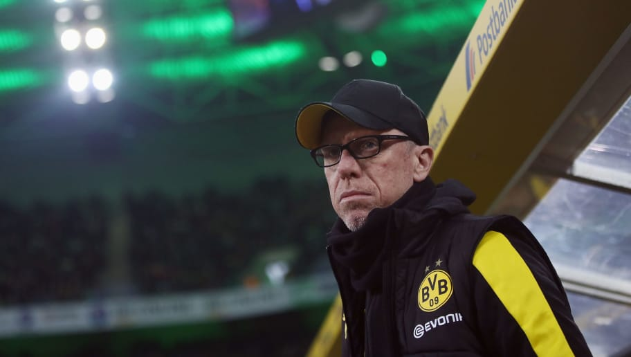 MOENCHENGLADBACH, GERMANY - FEBRUARY 18: Head coach Peter Stoeger of Dortmund looks on prior to the Bundesliga match between Borussia Moenchengladbach and Borussia Dortmund at Borussia-Park on February 18, 2018 in Moenchengladbach, Germany.  (Photo by Alex Grimm/Bongarts/Getty Images)