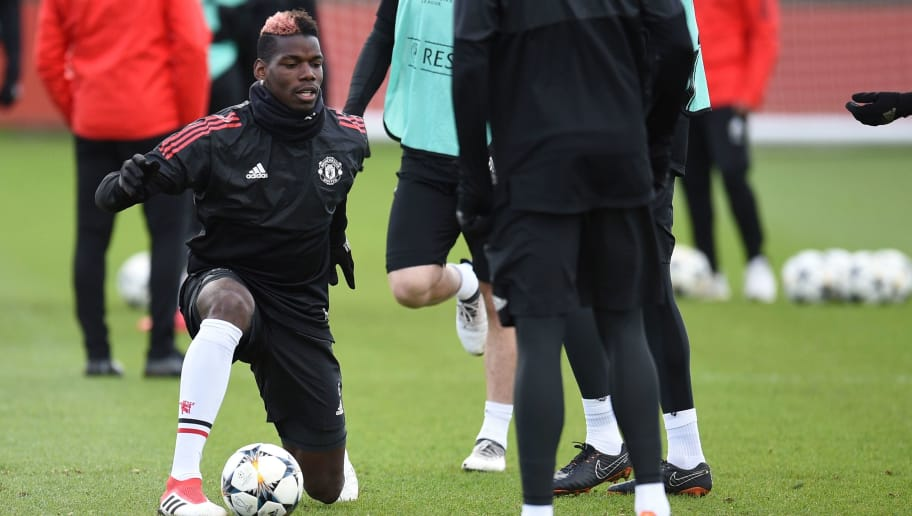 Manchester United's French midfielder Paul Pogba (L) takes part in a team training session at the club's training complex near Carrington, west of Manchester in north west England on February 20, 2018, on the eve of their UEFA Champions League round of 16 football match against Sevilla. / AFP PHOTO / Oli SCARFF        (Photo credit should read OLI SCARFF/AFP/Getty Images)