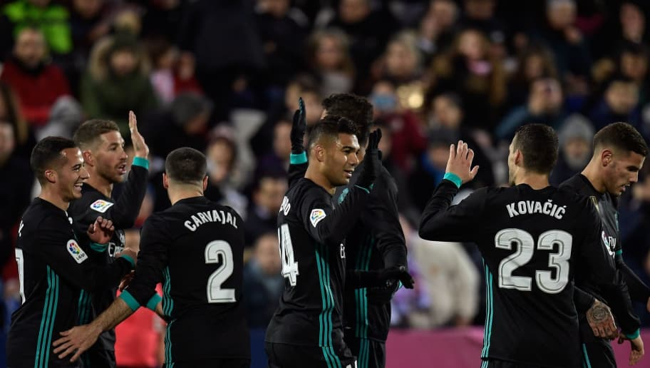 Real Madrid's Brazilian midfielder Casemiro (C) celebrate with teammates after scoring during the Spanish league football match Club Deportivo Leganes SAD against Real Madrid CF at the Estadio Municipal Butarque in Leganes on the outskirts of Madrid on February 21, 2018. / AFP PHOTO / OSCAR DEL POZO        (Photo credit should read OSCAR DEL POZO/AFP/Getty Images)