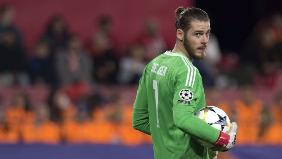 Manchester United's Spanish goalkeeper David De Gea looks on during the UEFA Champions League round of 16 first leg football match Sevilla FC against Manchester United at the Ramon Sanchez Pizjuan stadium in Sevilla on February 21, 2018. / AFP PHOTO / JORGE GUERRERO        (Photo credit should read JORGE GUERRERO/AFP/Getty Images)